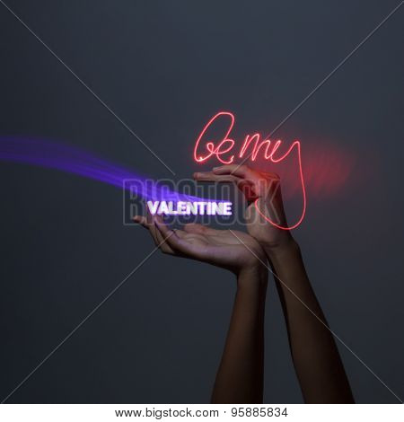 Light Painting Photography. Freezelight Photo. Hands Holding A Glowing Message With Freezelight Effe