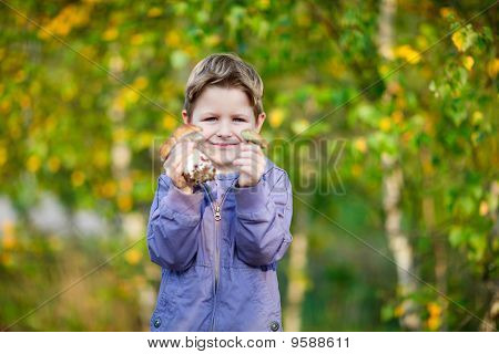 Happy Kid With Wild Mushrooms