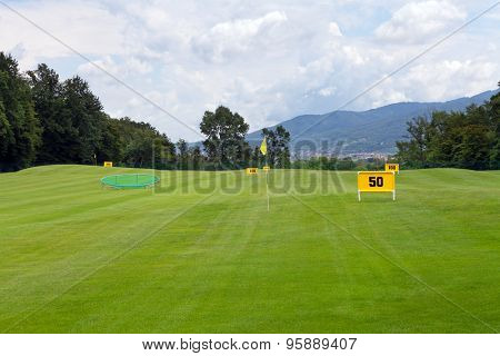 Practicing range at a golf course, with table marking 50 meters