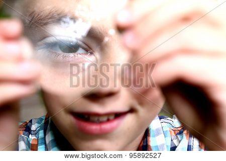 Preteen Boy Discover Suprising Characteristics On Convex Lens