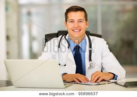 happy medical intern doctor sitting in office