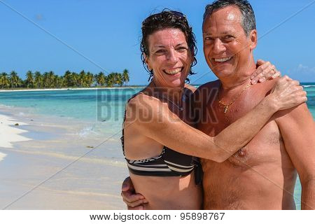 Happy Couple On A Beautiful Beach Of White Sand