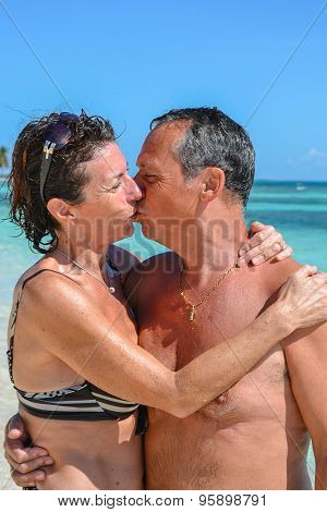 Kiss Of Love On A White Sand Beach