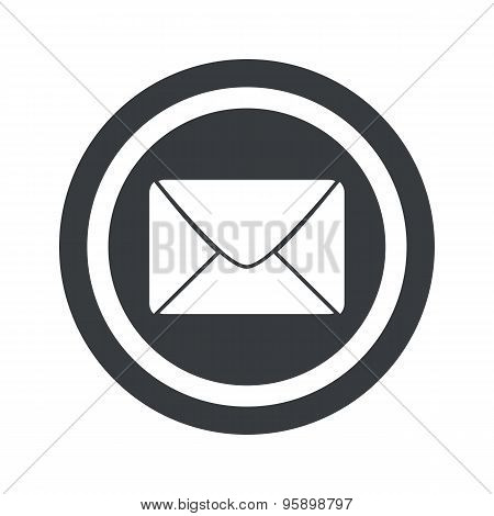 Round black letter sign