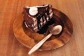 Постер, плакат: sweet brownie chocolate cream cake topped with white chocolate and cream with chocolate with chocola