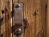 Antique Iron Handle On Weathered Door poster