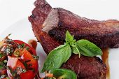 picture of braai  - fresh red beef meat steak barbecue garnished vegetable salad and basil  in half of pepper bell on white plate isolated over white background - JPG