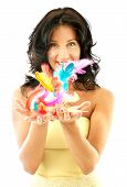 stock photo of happy easter  - happy girl in yellow corset throwing up easter feathers - JPG
