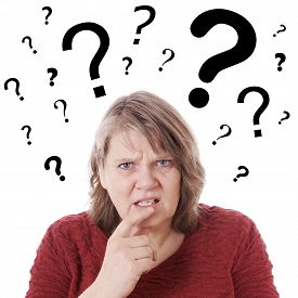 image of confusing  - elderly woman looking confused with question marks above her head - JPG