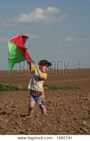 The Boy Starts A Kite