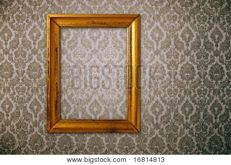 Gold frame over vintage wallpaper