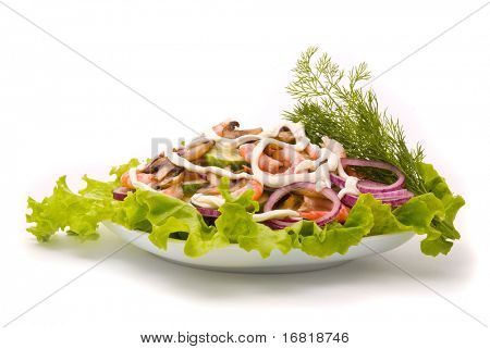 Salad from shrimps with field mushrooms, apples and cucumbers.