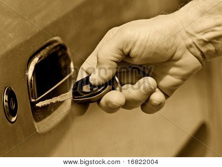 man open the door of his car