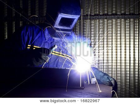 fine image of welder of work