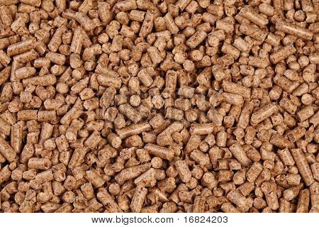 fine closeup image of natural wood pellet on white