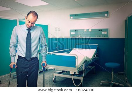 man with crutch in hospital background
