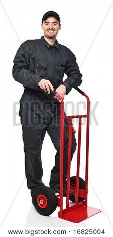 standing manual worker with red handtruck isolated on white