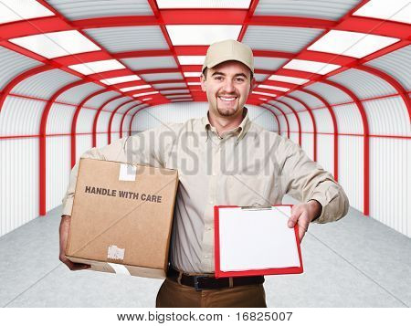 young delivery man on duty and 3d empty warehouse background