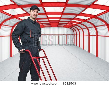 young manual worker in 3d warehouse background