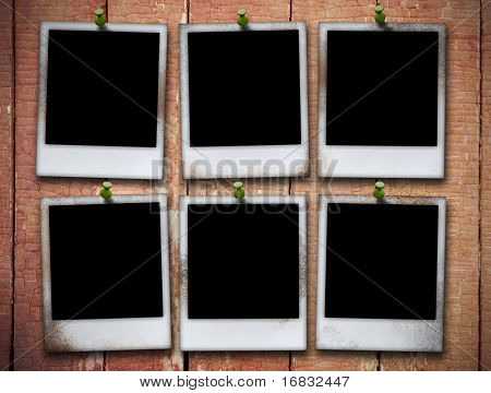 six photo frame on grunge wooden planks