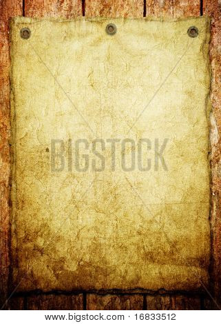 old paper on wood background (vintage announcement )