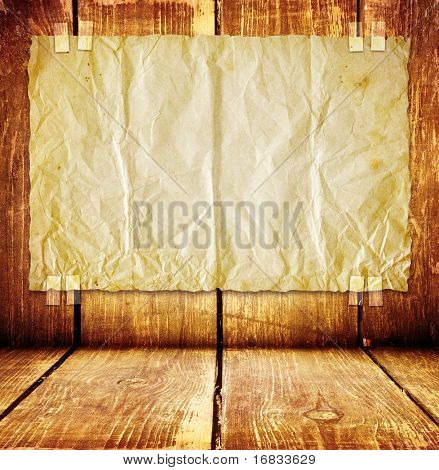 Wooden room with paper on wall