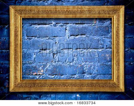 Golden frame on blue urban brick wall