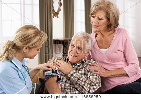 Health Visitor Taking Senior Man's Blood Pressure
