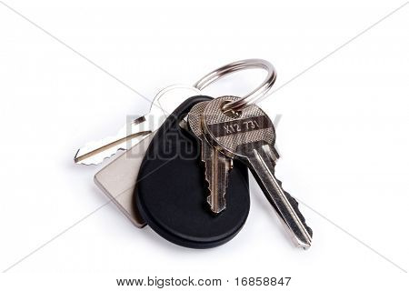 Three keys on keyring isolated over white