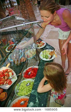 Mum And Daughter Choose Meal