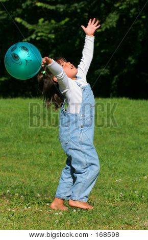 A Child And Her Ball