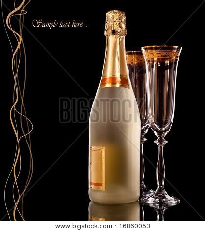 Bottle of Champagne and two empty champagne glasses