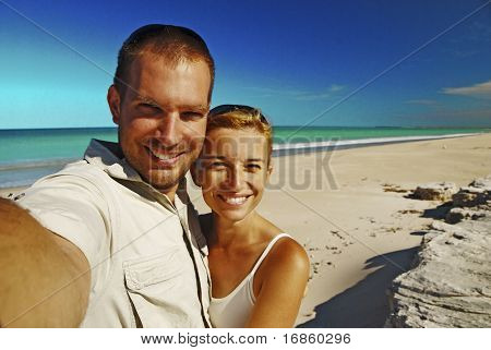 Couple Taking Photo On The Beach