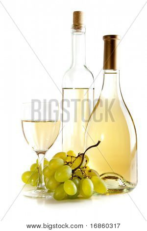 wine bottles and glass with bunch of grapes over white background
