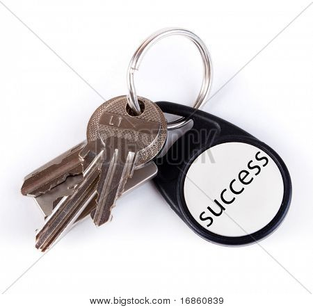 Three keys on keyring isolated over white
