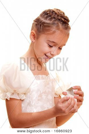 Little girl holding small gift box in hands