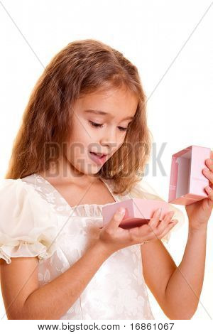 Little girl holding small gift box in hand