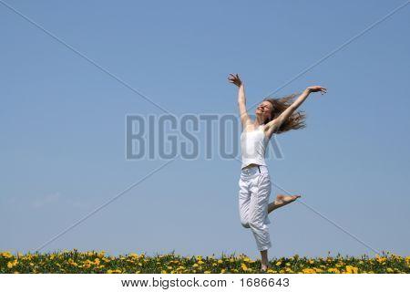 Smiling Girl Dancing In Dandelion Field