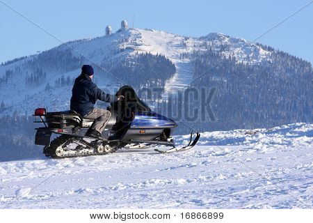 Man on snowmobile in the Sumava National Park - Czech Republic Europe