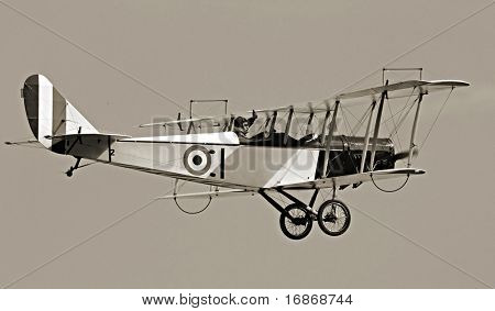 Historic biplane on the sky - vintage photography