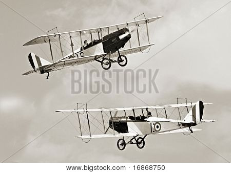 Two historic biplanes on the sky - vintage photography