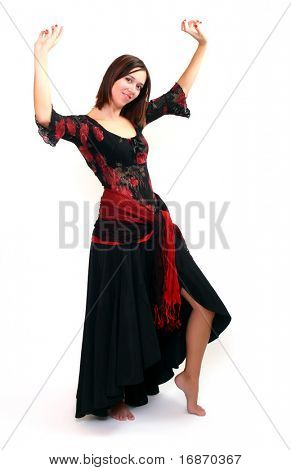 Beautiful female Spanish Flamenco dancer doing a typical line pose, wearing modern attire. Spanish woman dancing Paso Doble in red and black dress clothes.Studio shot on white background.
