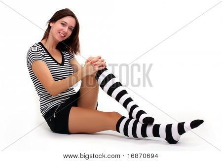 Sexy girl in funny socks . Studio shot over light grey background