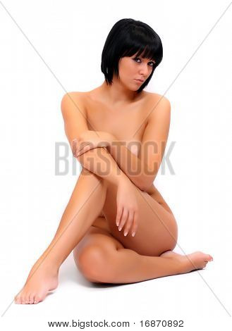 Picture of sitting healthy naked woman over white.