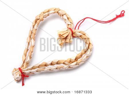 Handmade christmas decoration hearth from straw, traditional Czech souvenir, isolated on white