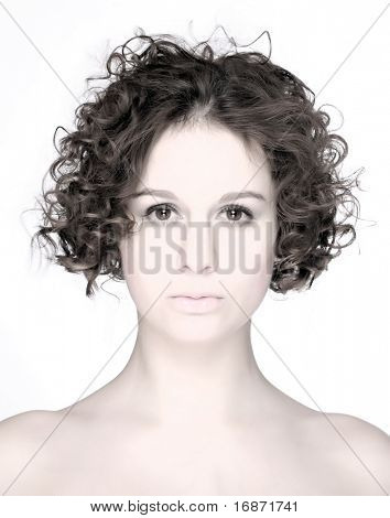 High key portrait of beautiful curly woman. Studio shot.