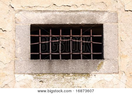 Prison window with damaged rusty bar. Conceptual image.Iron curtain - Freedom metaphor.