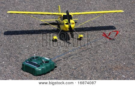 Homemade radio control aircraft with electric motor on runway.