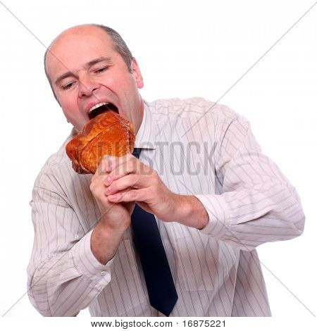 Hungry businessman eating ham.