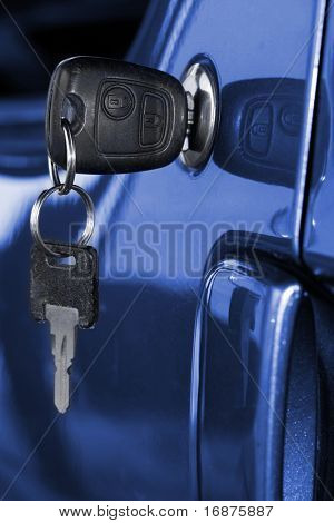 Key at car doors - close up with shallow DOF